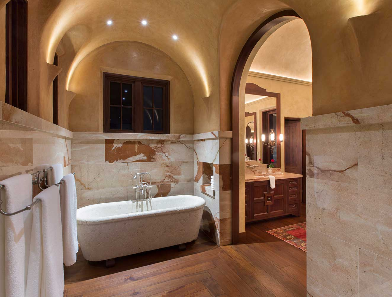 Arched master bathroom in a Naples Florida, luxury home. Designed by Kukk Architecture & Design Naples.