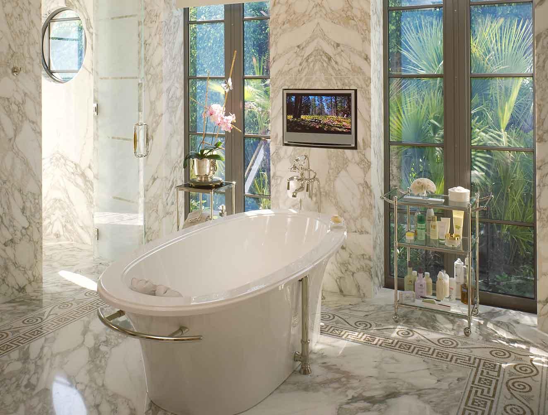 Custom marble free-standing bathtub in a Naples Florida, master bathroom. Designed by Kukk Architecture & Design Naples.