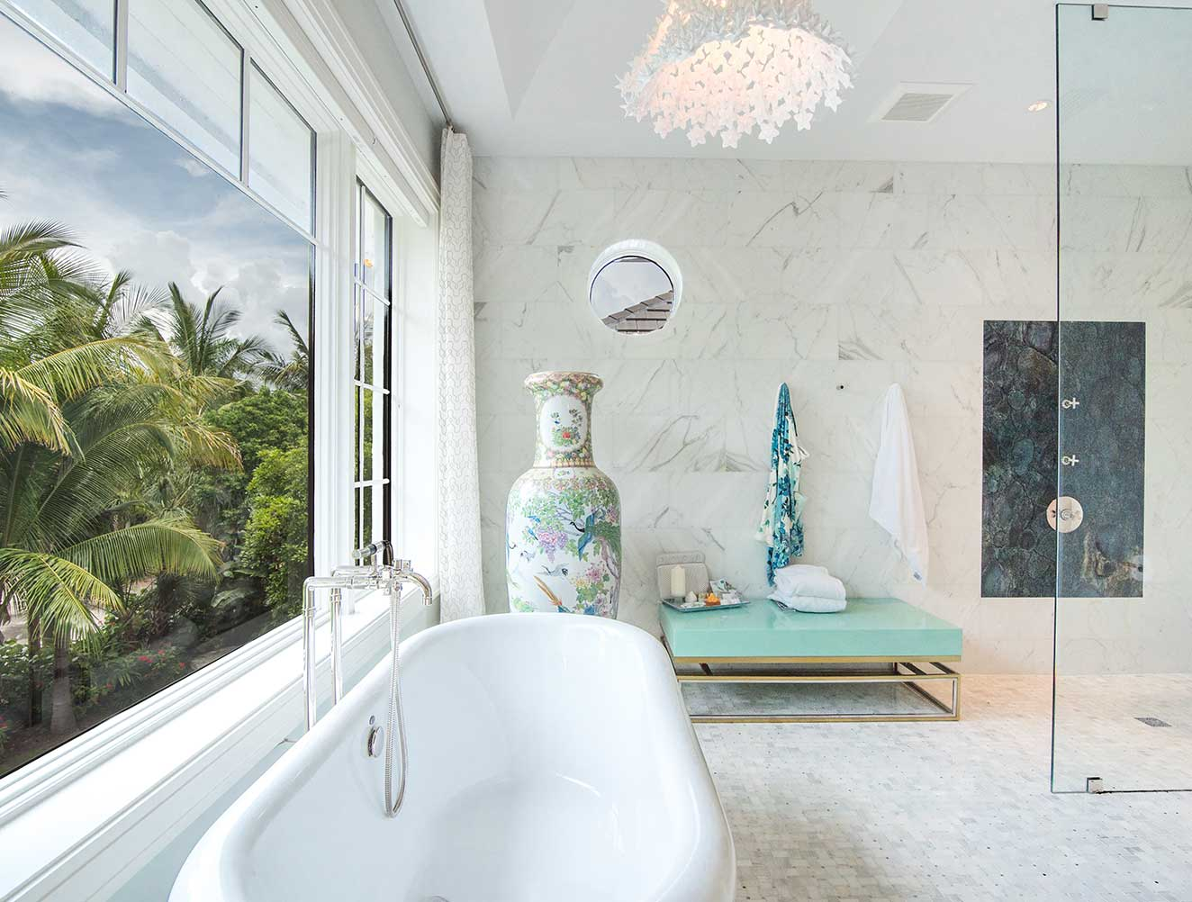 Peaceful master bathroom with free standing tub in a Naples Florida, single family home. Designed by Kukk Architecture & Design Naples.
