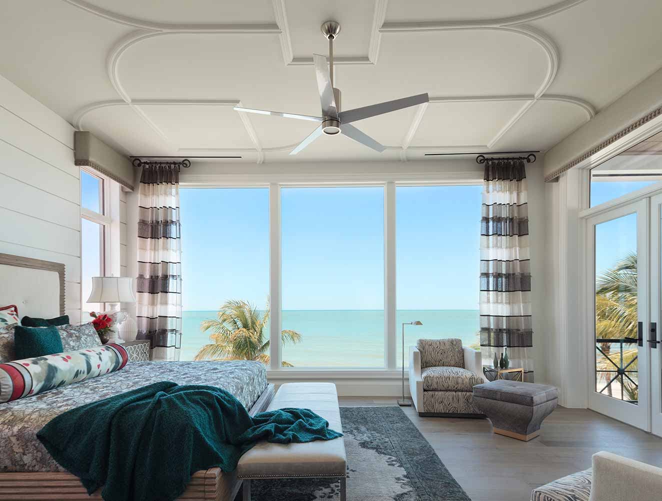 Master bedroom with ocean views in a Naples Florida, single family home. Designed by Kukk Architecture & Design Naples.