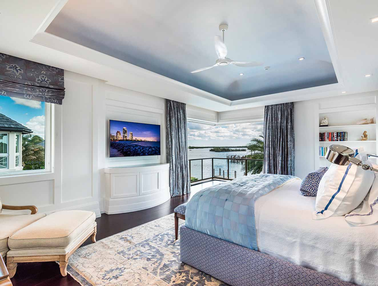 Master bedroom with elevated waterfront views in a Naples Florida, single family home. Designed by Kukk Architecture & Design Naples.