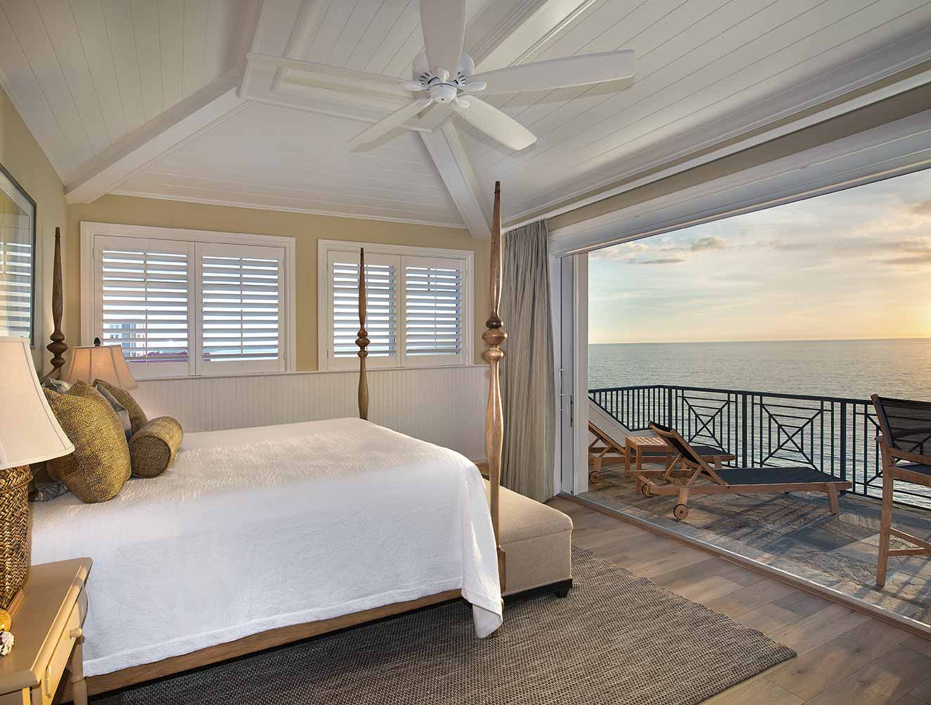 Master bedroom opens to ocean views in a Naples Florida, single family home. Designed by Kukk Architecture & Design Naples.