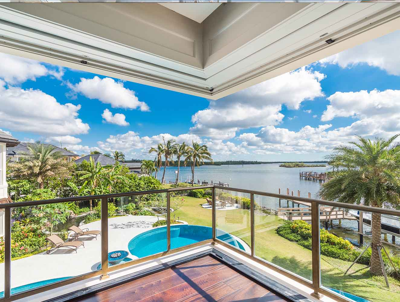 Waterfront views highlighted by architectural features at Nelson's Walk Residence in Naples Florida, single family home designed by Kukk Architecture & Design Naples Architecture Firm