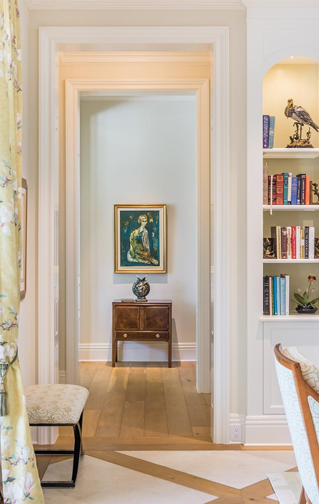 Built-in Bookcase and Hallway at Cove Residence in Naples Florida, single family home designed by Kukk Architecture & Design Naples Architecture Firm