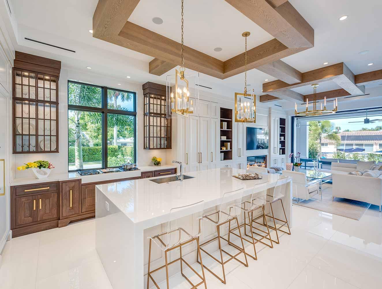 White Marble Kitchen with Wood Accent. Kitchen Galleries Architectural Design Portfolio. Designed by Kukk Architecture & Design Naples.