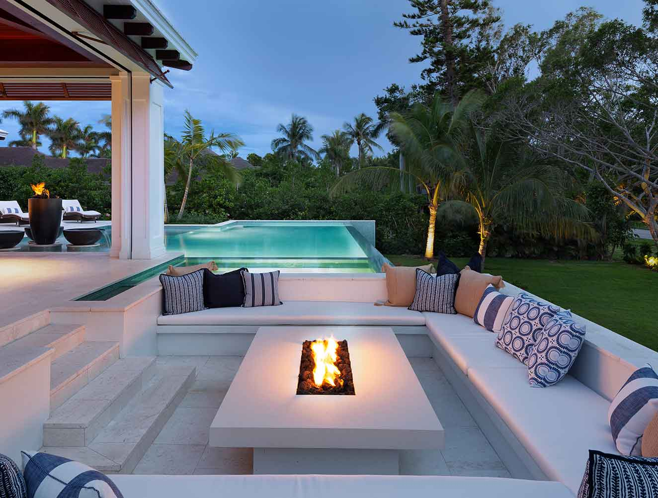 Portfolio of Leisure Spaces in Naples, Florida Luxury Homes. Leisure Outdoor fire pit with built-in seating. Designed by Kukk Architecture & Design Naples.