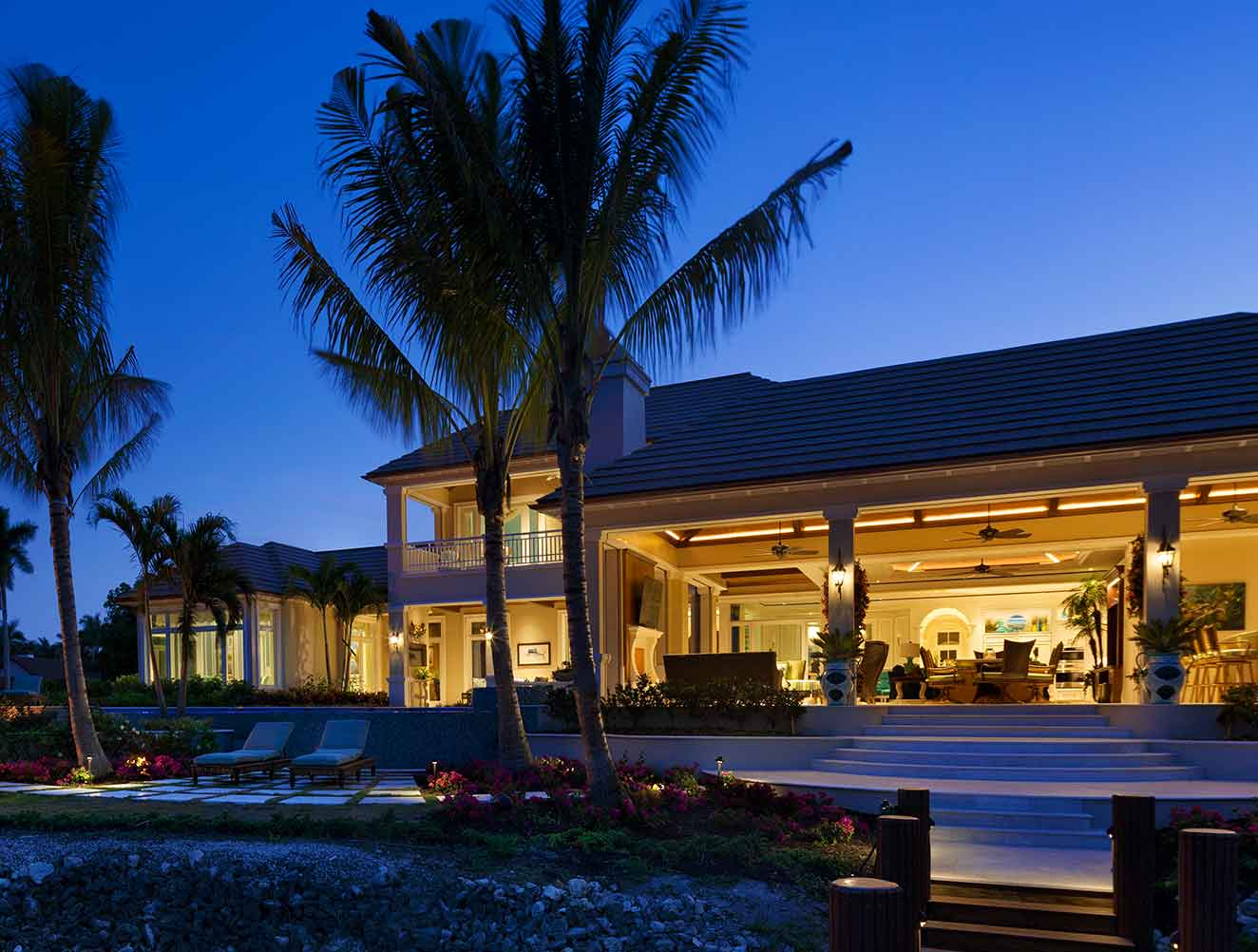 Portfolio of Leisure Spaces in Naples, Florida Luxury Homes. Leisure Outdoor Covered Dining space. Designed by Kukk Architecture & Design Naples.
