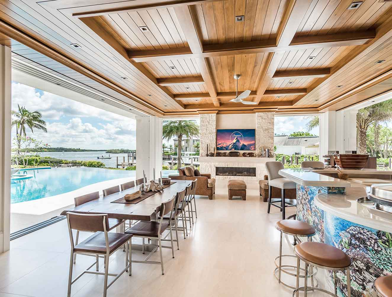 Portfolio of Leisure Spaces in Naples, Florida Luxury Homes. Leisure Outdoor Covered Family Room. Designed by Kukk Architecture & Design Naples.