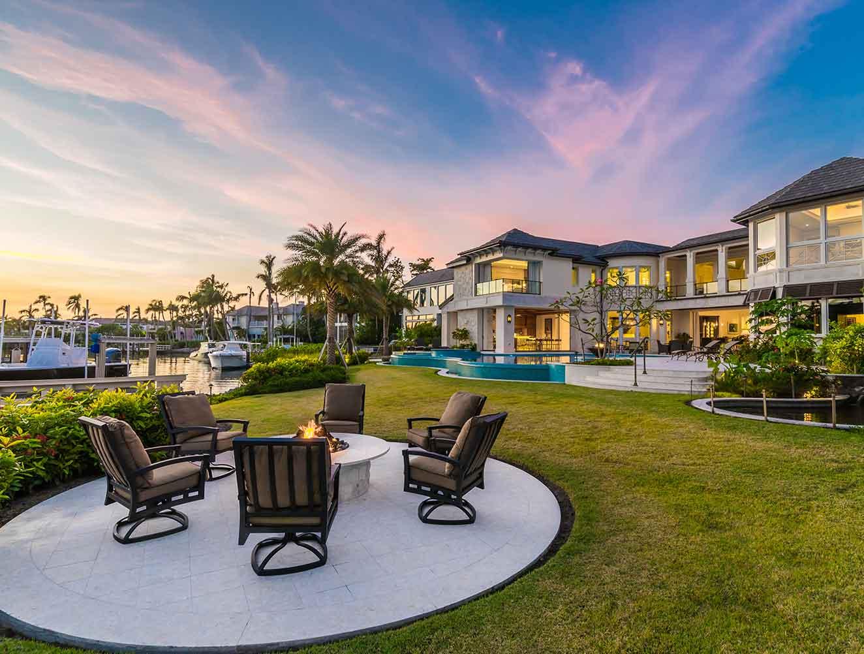 Portfolio of Leisure Spaces in Naples, Florida Luxury Homes. Waterfront firepit. Designed by Kukk Architecture & Design Naples.