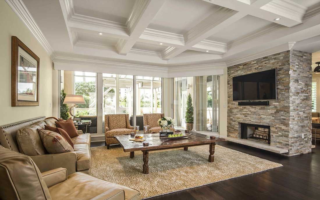 Naples Florida living room with large, stone fireplace designed by Kukk Architecture & Design, P.A. | Blog: Remodel 101