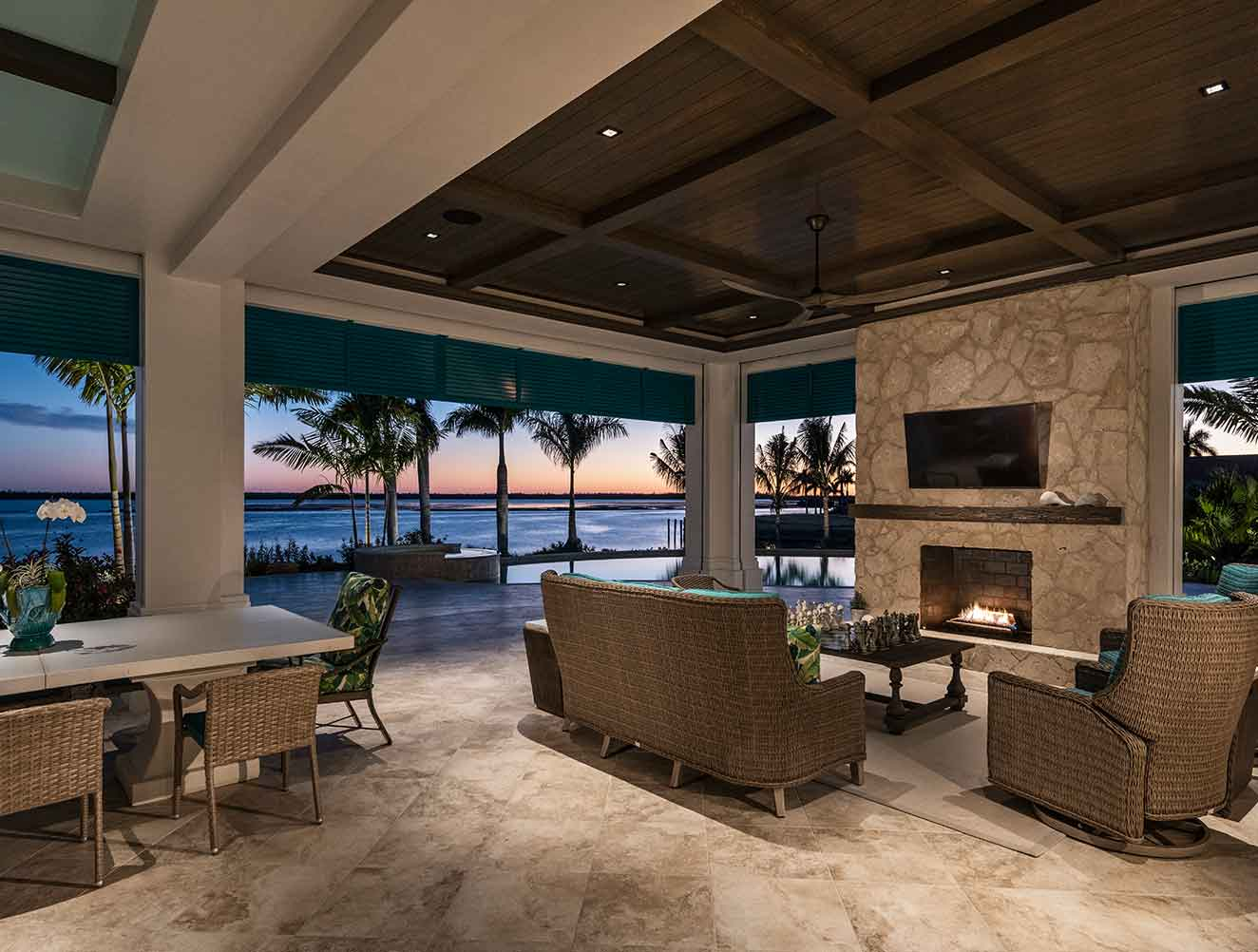 Outdoor Seating with waterfront views at Caxambas Residence in Naples Florida, single family home designed by Kukk Architecture & Design Naples Architecture Firm