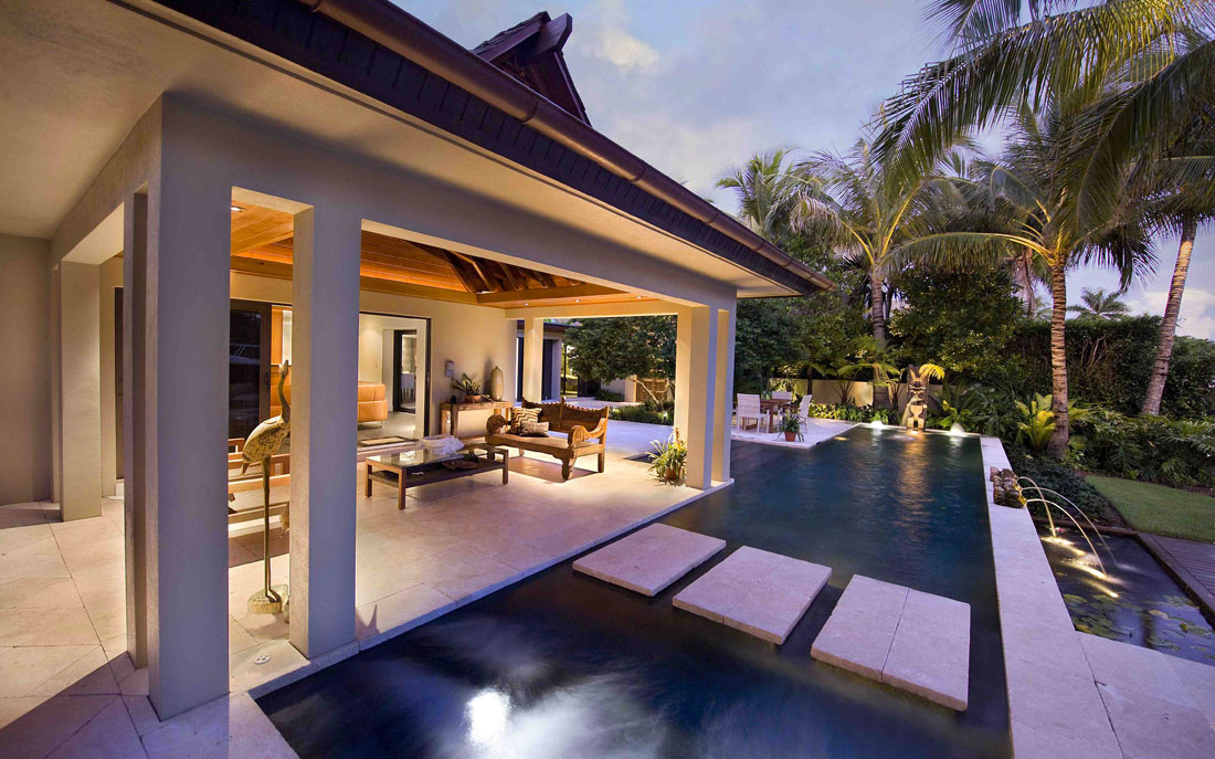 Mordern Naples, Florida home with outdoor seating area and pool | Blog: Kukk Architecture Receives Best Of Houzz 2015 Award