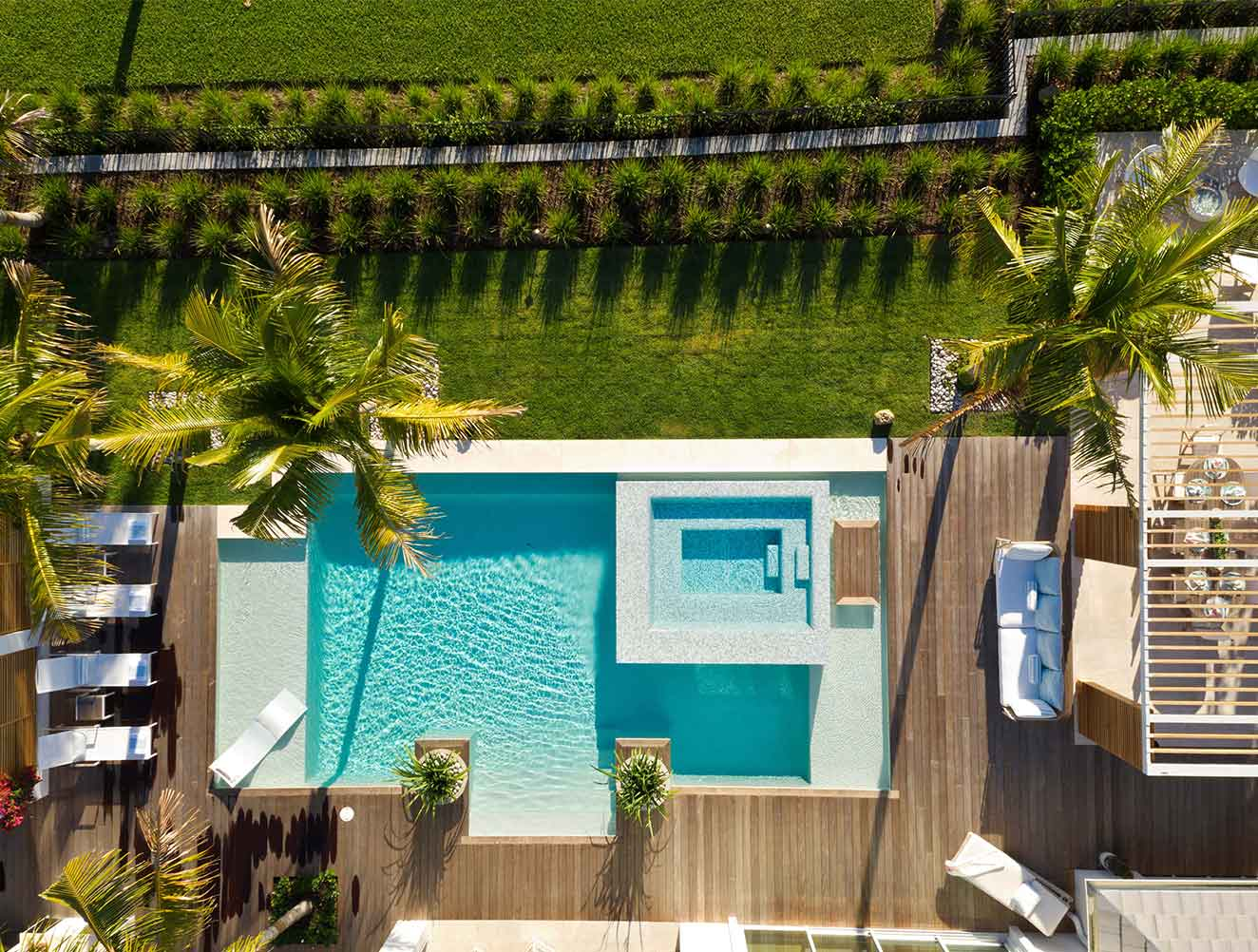 Portfolio of Pools in Naples, Florida Luxury Homes. Infinity pool with Bayfront views aerial photography. Designed by Kukk Architecture & Design Naples