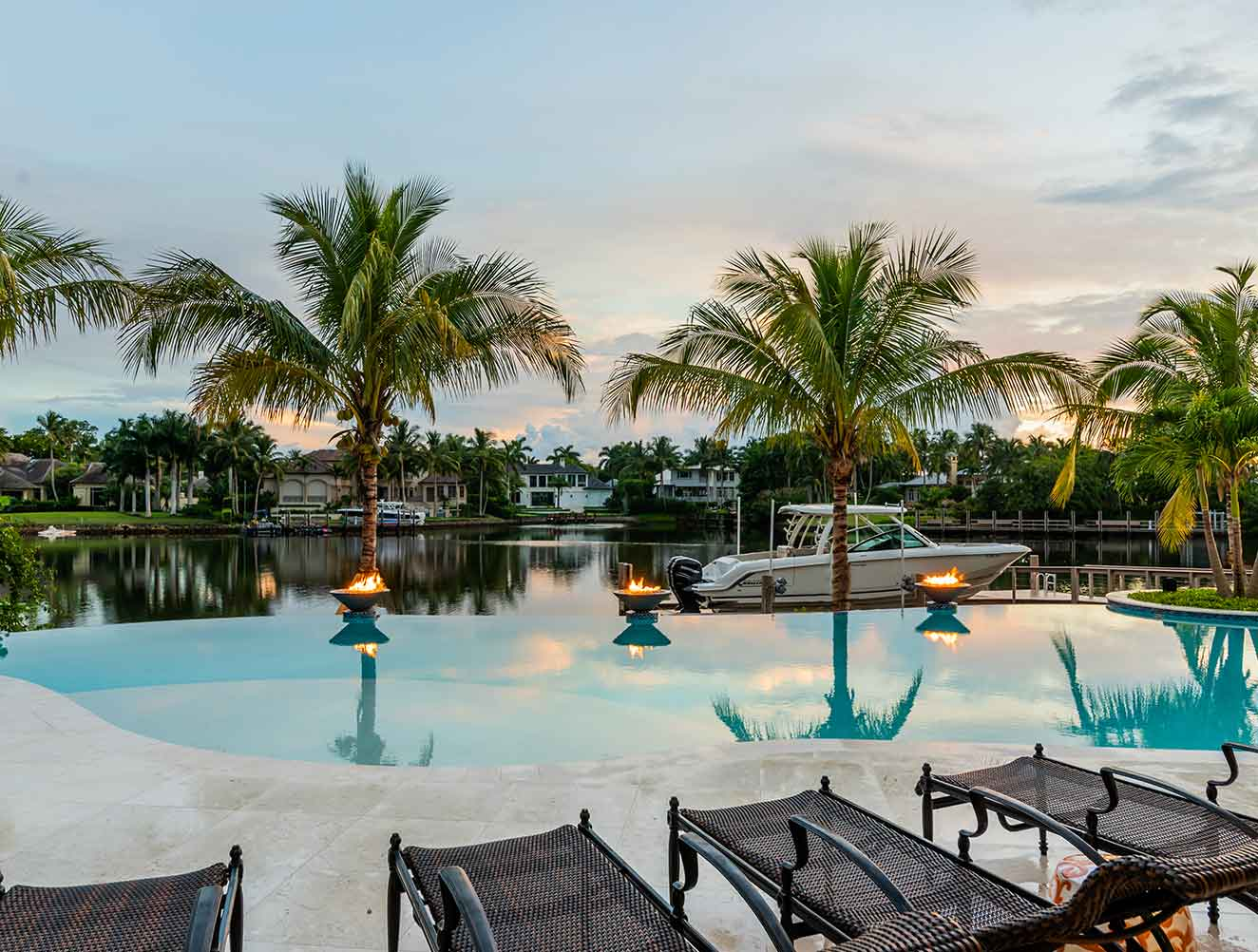Portfolio of Pools in Naples, Florida Luxury Homes. Infinity pool with Bayfront views. Designed by Kukk Architecture & Design Naples