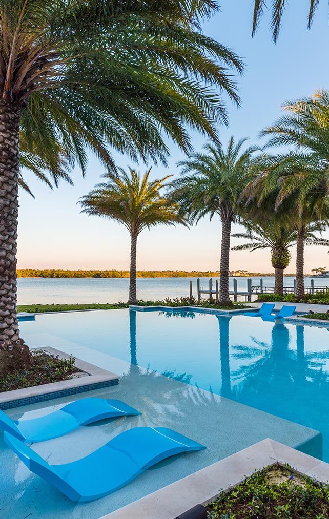 Portfolio of Pools in Naples, Florida Luxury Homes. Bayfront Infinity Pool. Designed by Kukk Architecture & Design Naples.