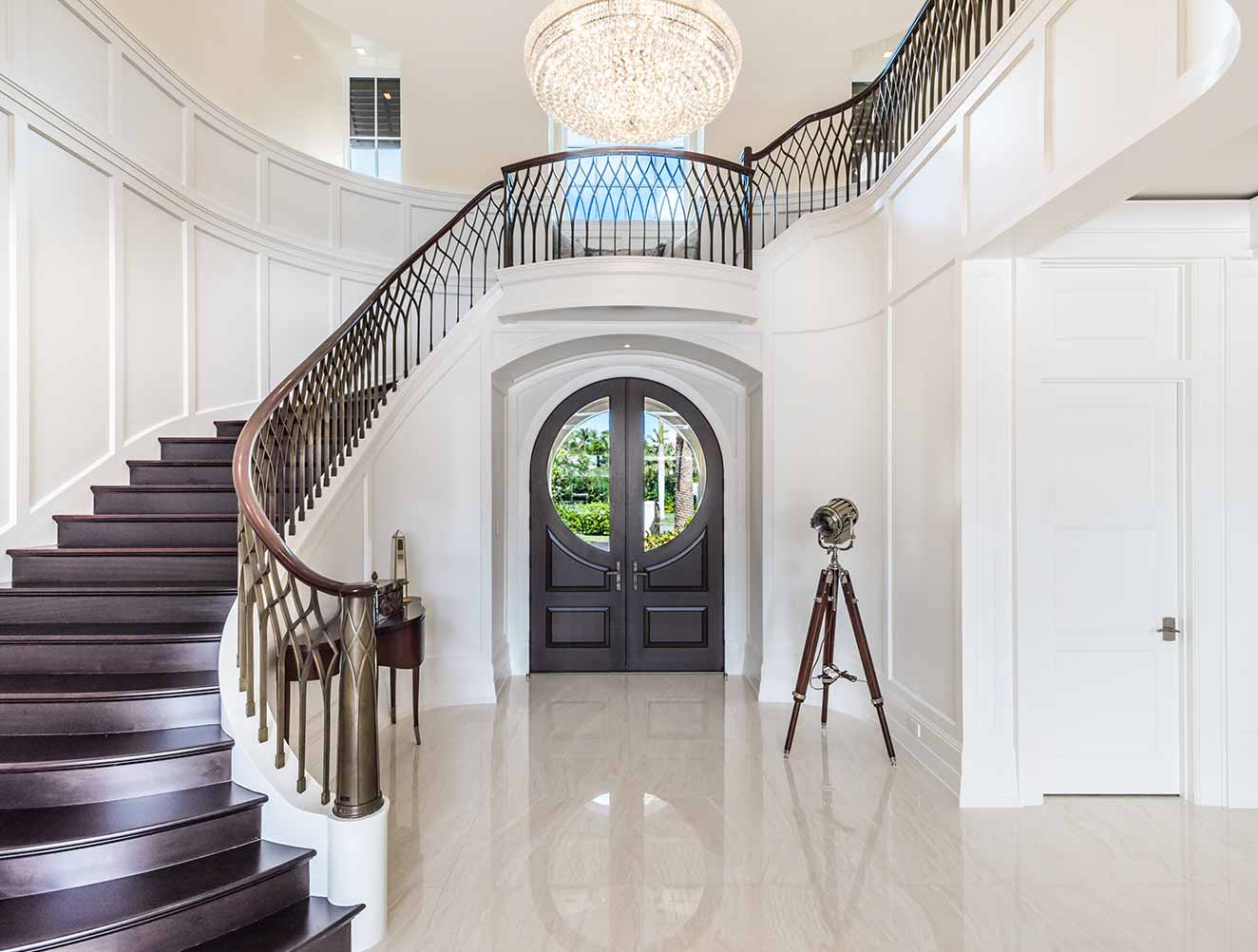 Portfolio of Custom Staircase Design in Naples, Florida Luxury Homes. Modern wood staircase with metal railing details. Designed by Kukk Architecture & Design Naples.