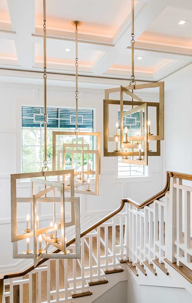 Portfolio of Custom Staircase Design in Naples, Florida Luxury Homes. Decorated staircase with modern candelabras. Designed by Kukk Architecture & Design Naples.