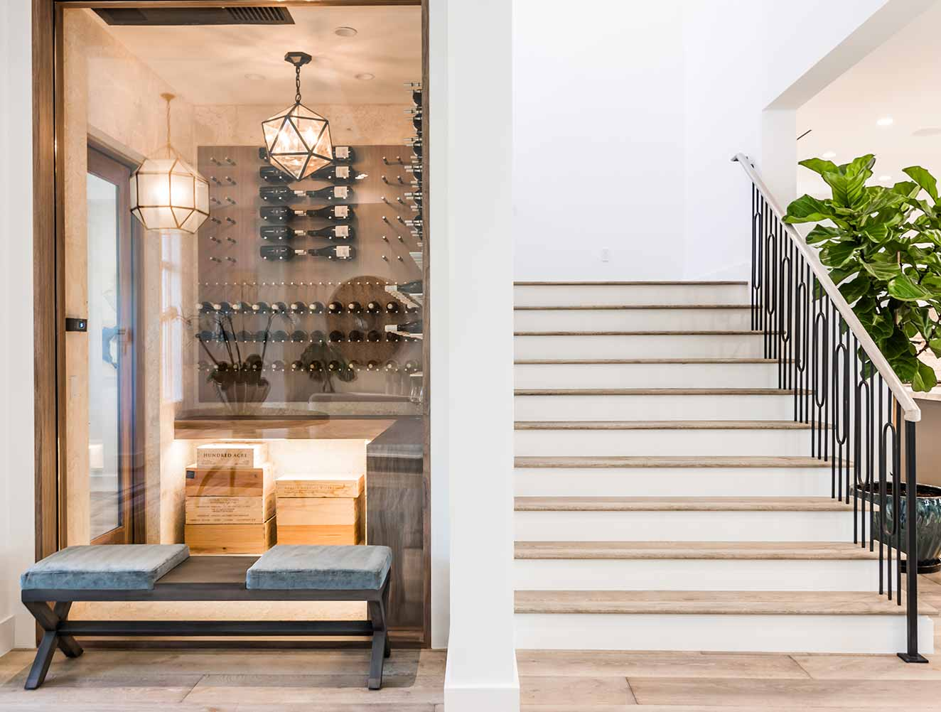 Portfolio of Custom Staircase Design in Naples, Florida Luxury Homes. Staircase and wine cellar. Designed by Kukk Architecture & Design Naples