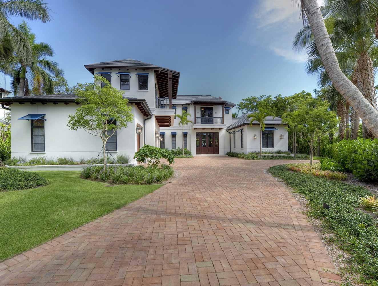 Front Entry and drive at Little Harbour Residence in Naples Florida, single family home designed by Kukk Architecture & Design Naples Architecture Firm